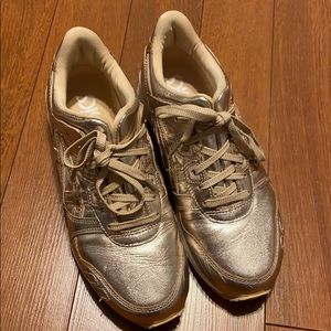 Olympic gold ASICS sneakers. Used but in ok shape.